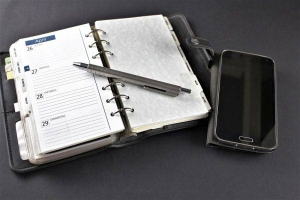 Organiser with a pen and phone