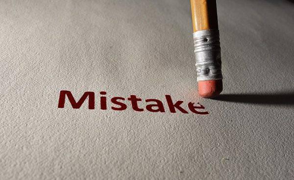Pencil rubber erasing word mistake