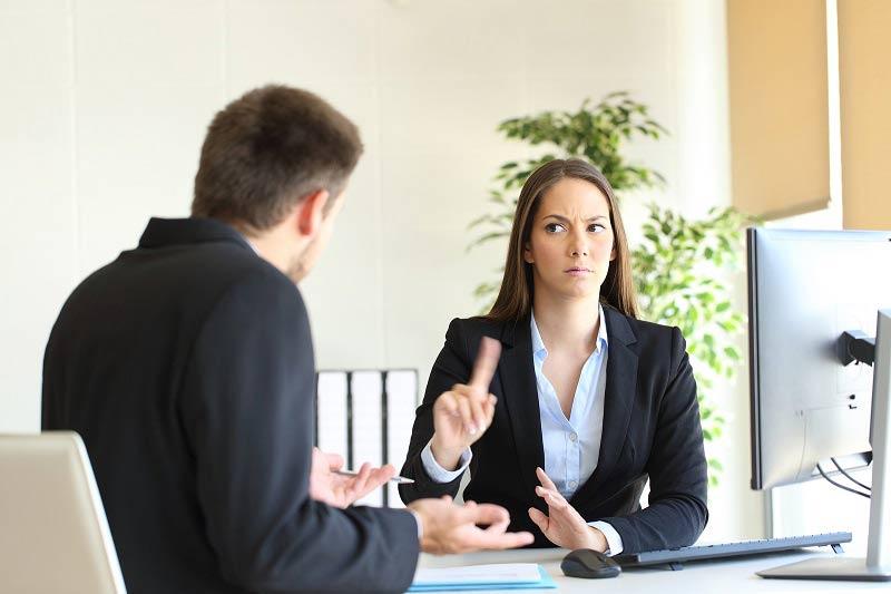 Businesswoman saying no to salesman