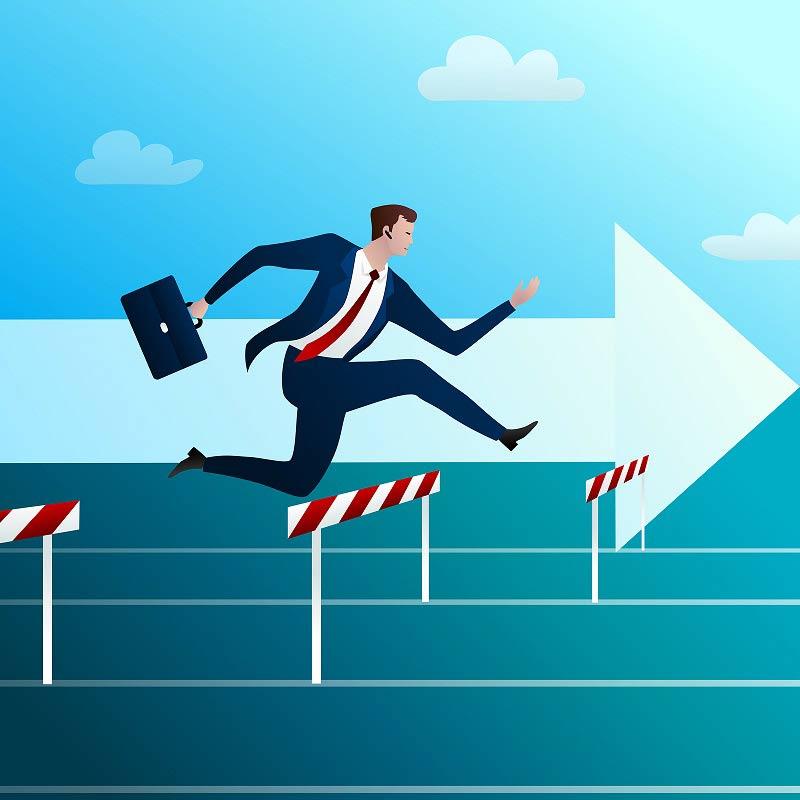 Cartoon businessman jumping over hurdles
