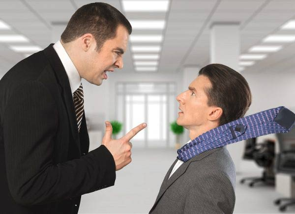 Angry worker shouting at colleague