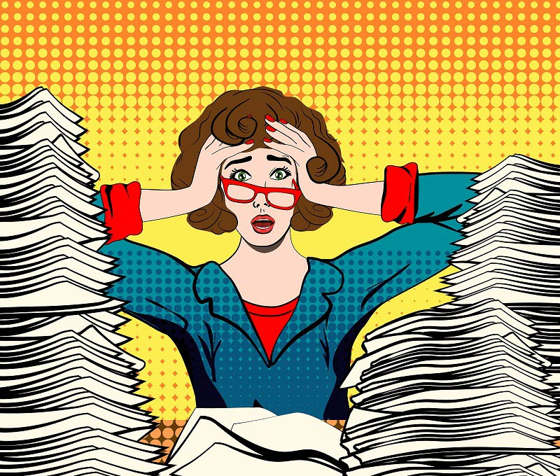 Stressed woman with lots of paperwork