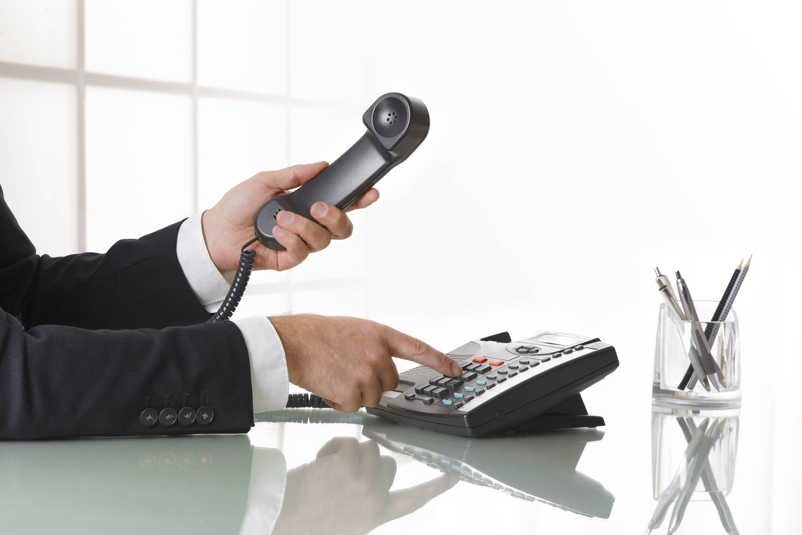 Businessman dialling a phone