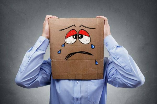 Businessman with sad face cardboard box