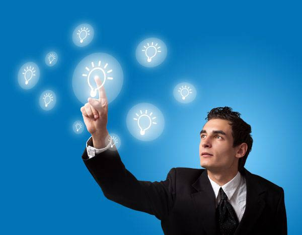 Businessman pressing digital lightbulb