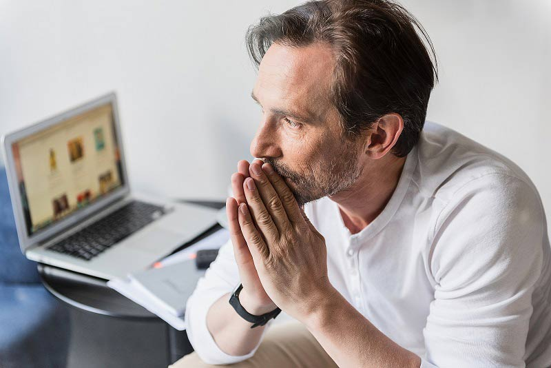Man concentrating on work and ideas