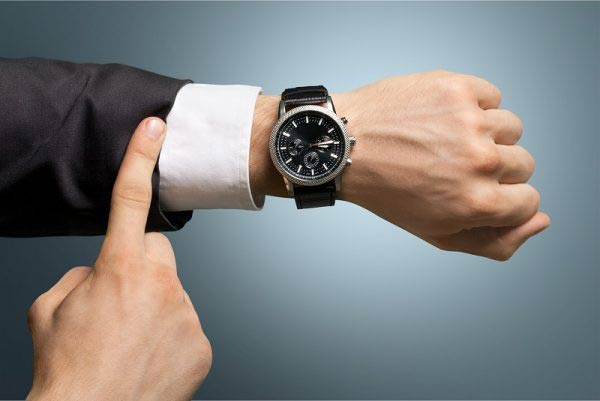 Businessman with a watch on
