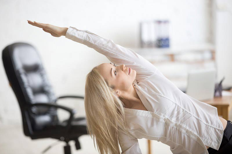 Business woman doing exercises at desk