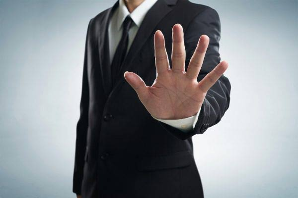 Businessman gesturing stop with hand