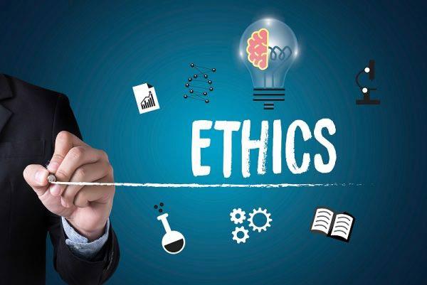 Businessman writing ethics