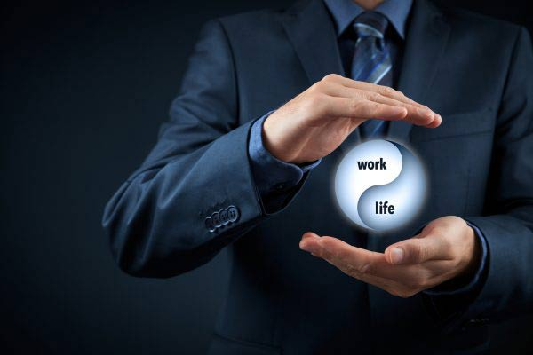 Man holding digital work life ball