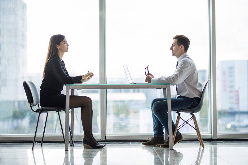 Business man and woman having a meeting