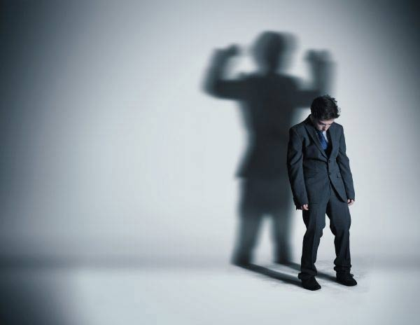 Businessman with strong shadow
