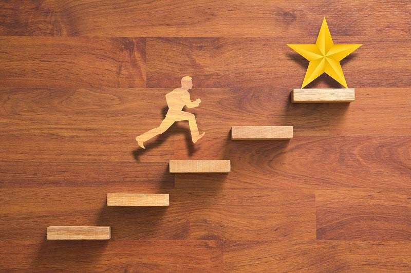Wooden stairs and figure chasing star