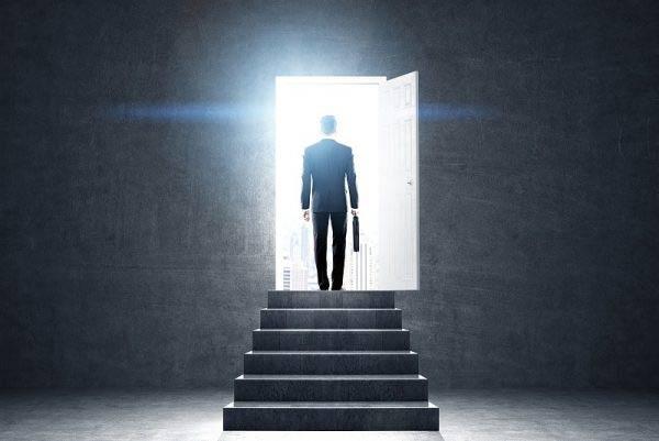 Businessman walking through a door