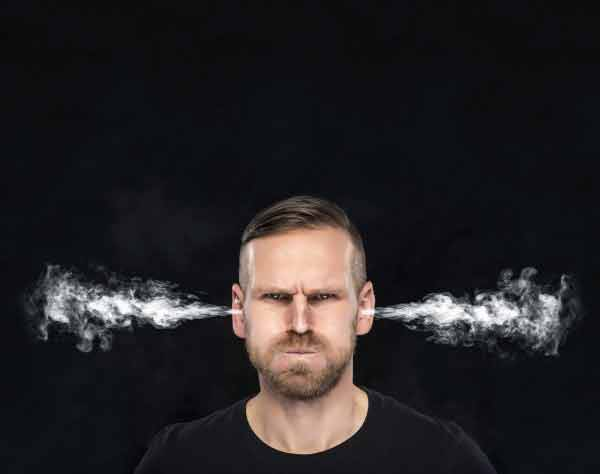 Angry man with smoke coming