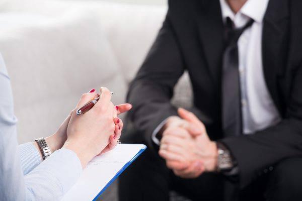 psychiatrist examining a male