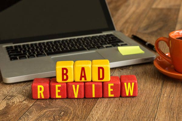 Bad Review written on a wooden