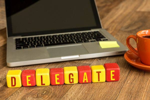 Delegate written on a wooden