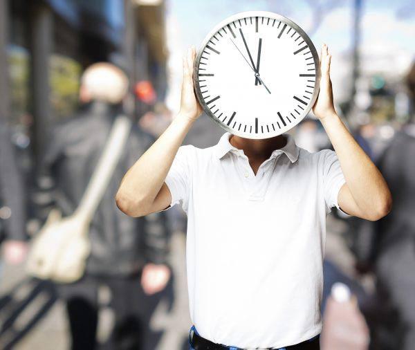 portrait of a man holding a clock