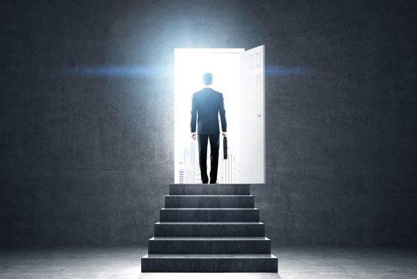 Businessman walking through the door
