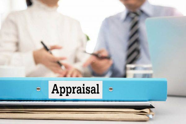 Blue appraisal folder with meeting in background