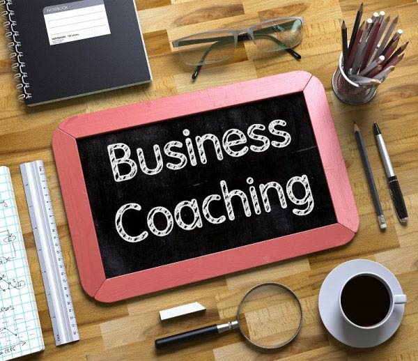 Business Coaching written on chalk board