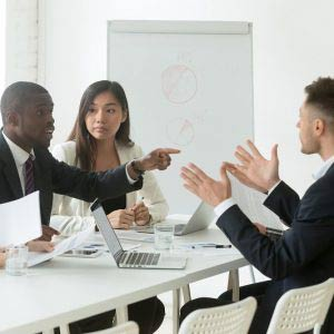 Employees arguing in a meeting