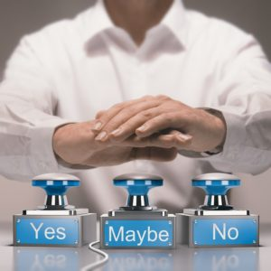Businessman pressing yes, no or maybe buzzers