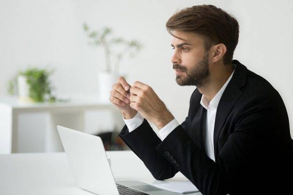 Businessman thinking at work