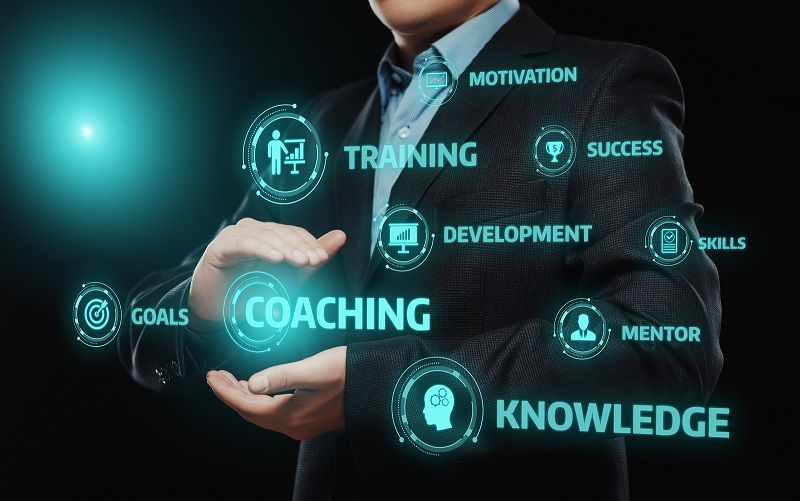 Businessman with digital coaching button