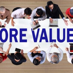 Core Values with employees around a table