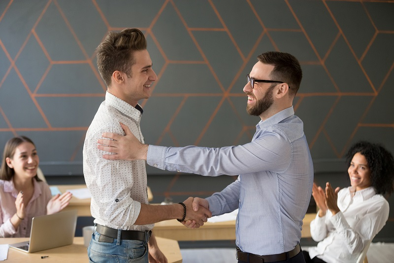 Manager shaking hands with an employee