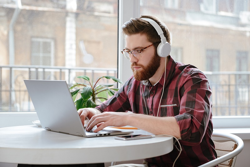 Person concentrating with earphones on